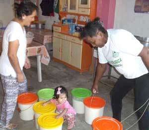 Collecting-the-milk-with-the-help-of-Jenny's-granddaughter web